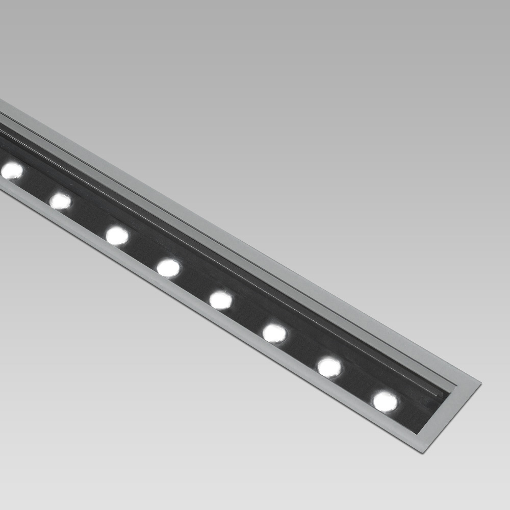 Linear in-ground luminaire with high performance and a wide range of light beams to create scenographic light effects and suggestive luminous patha
