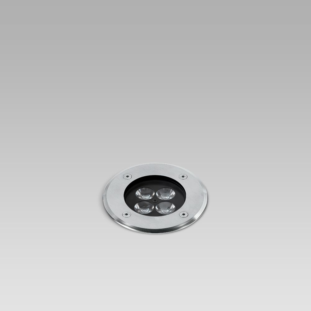 In-ground recessed luminaire for outdoor lighting, requiring shallow installation depth, available with different trims